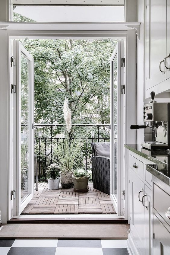 extend your kitchen or another space with a balcony, add potted plants and comfy furniture