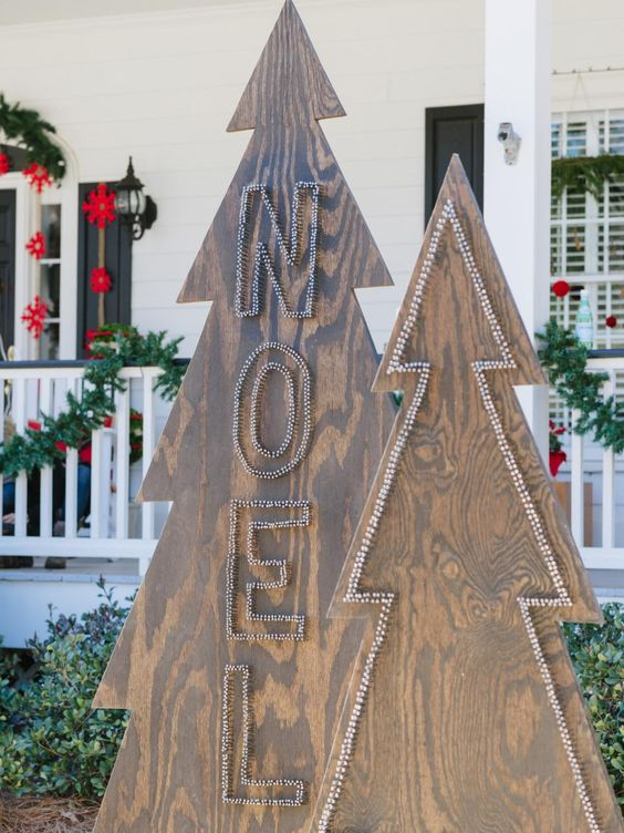 plywood Christmas trees decorated with nail heads will be a nice idea for any outdoor space