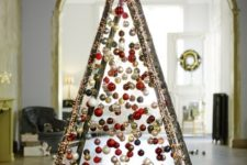28 take a usual ladder and cover it with lights, then attach Christmas ornaments on various heights to form a creative tree