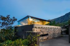 01 This contemporary family home features a unique pyramid roof and the upper floor, which is maximally exposed