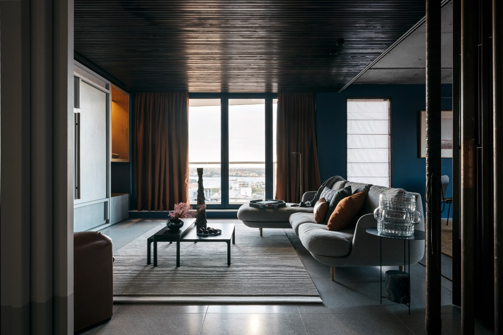 This stunning refined apartment is done in rich colors and shades, it's functional and layered, it's stylish and chic