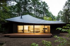 01 This unique minimalist weekend home looks like a pile of leaves and it's really inspired by one