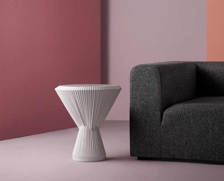 This unique modern side table is called Plisago and it's made of porcelain yet looks like of fabric