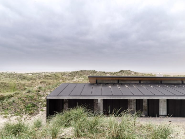 The outside of the house is done in black, while the interiors are done in neutrals