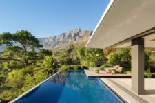large pool with a gorgeous stone deck