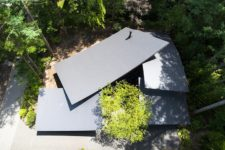 This is how the house looks from above, there are four curved roofs and they resemble leaves