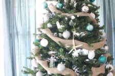 rustic-looking christmas tree with burlap decor