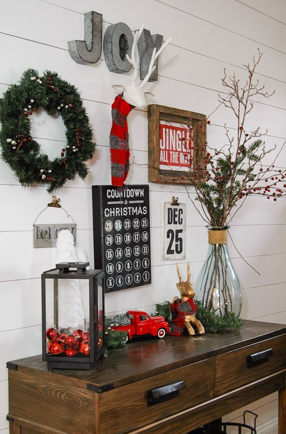 a bright gallery wall with an advent calendar, signs, metal letters and a wreath to count down to Christmas