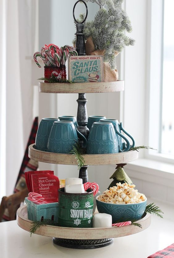 a classic hot cocoa and sweets station organized using a cupcake stand is what you need for holidays