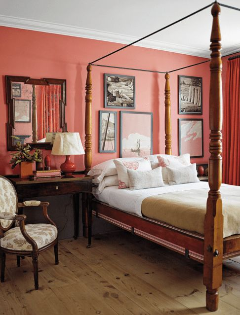 a statement wall and curtains in the vintage bedroom give it a bit of edge and much color