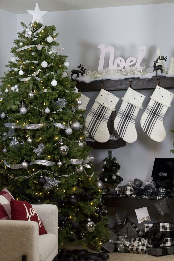 an ultra modern Christmas tree from white and silver to black plus silver ribbon and lights for a monochromatic space