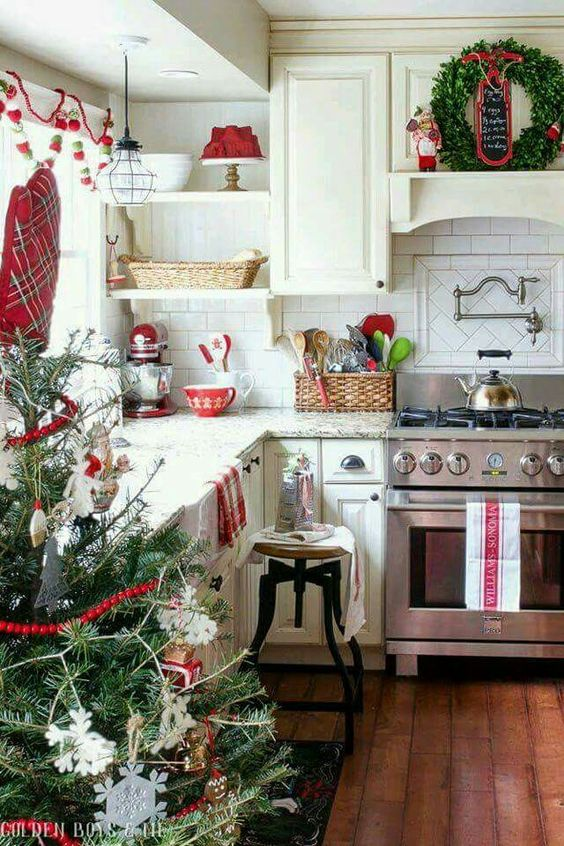 a neutral kitchen was spruced up with reds and evergreens and looks very natural and holiday-like