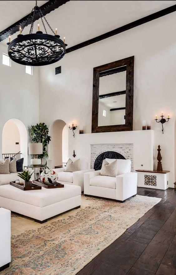 white plaster walls make up a great base for a Mediterranean space, dark wooden floors will contrast them