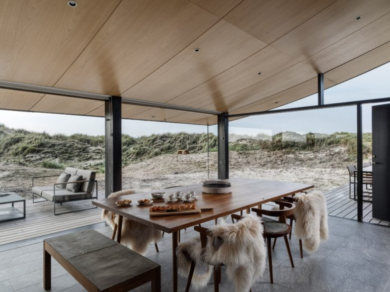 The indoor spaces are strongly connected to outdoors through extensive glazing