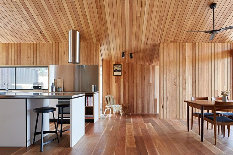 The interior is clad with light-colored wood completely to make it warming up and welcoming