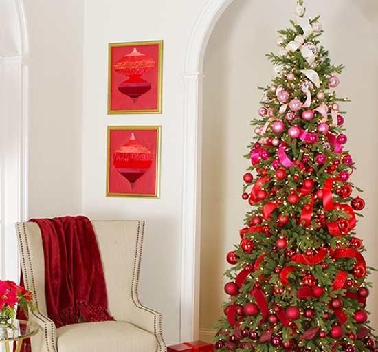 a beautiful and bright ombre Christmas tree from light pink to hot pink and red and burgundy plus lights