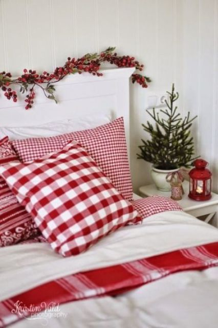 a bedroom in whites can be refreshed with holiday reds, berries, a lantern and even traditional bedding