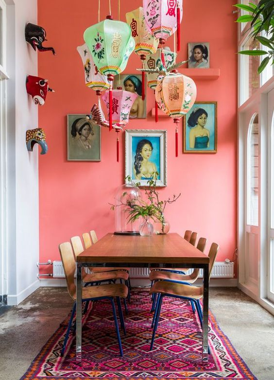 a coral pink statement wall is great for a boho and gypsy interior with eastern influence like this one