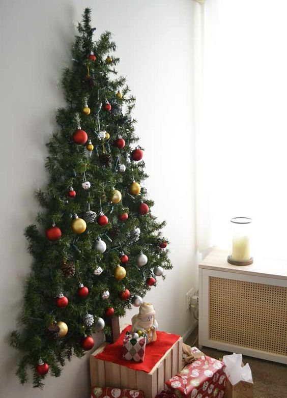try various creative ideas, for example, a wall-mounted Christmas tree, which won't take much space