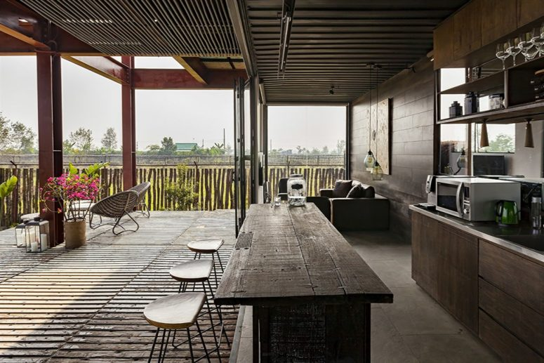 Reclaimed wood and metal were widely used throughout the residence, and all the spaces can be opened to outdoors