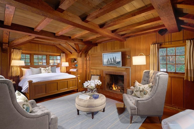 The bedrooms looks like out of a movie, with much teak wood and grey and light blue linens and upholstery
