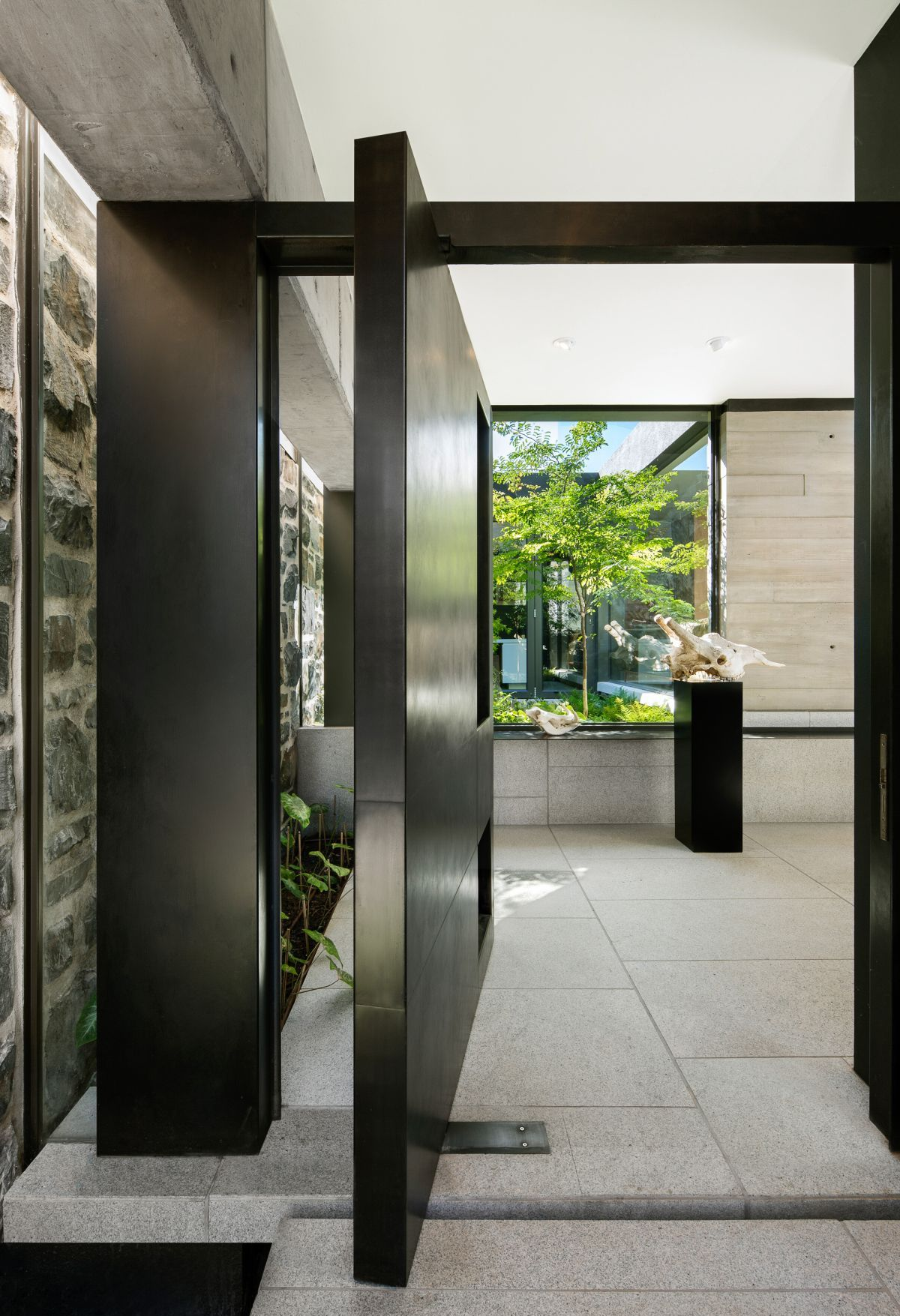 The front door is made of metal and is pivoting