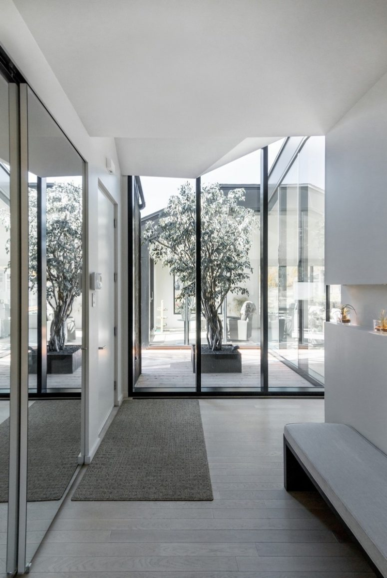 The spaces of the house enjoy much natural light and amazing views plus entrances to the multiple terraces