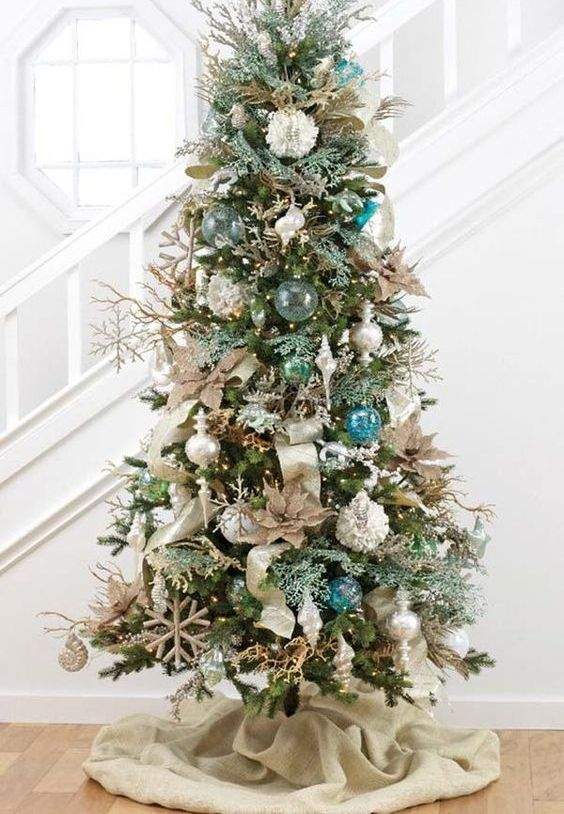 a brilliant Christmas tree with float-like ornaments, metallic ornaments and burlap decorations isn't that evidently coastal