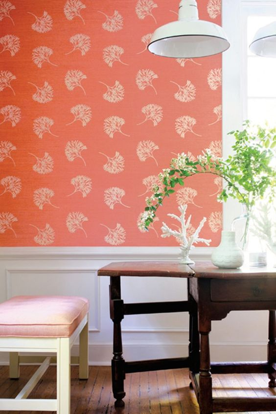 a coral botanical print wallpaper wall is great to refresh your breakfast nook and make it warm and inviting
