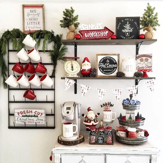 a hot coffee and chocolate station with traditional mugs, evergreens, pinecones and other cute details