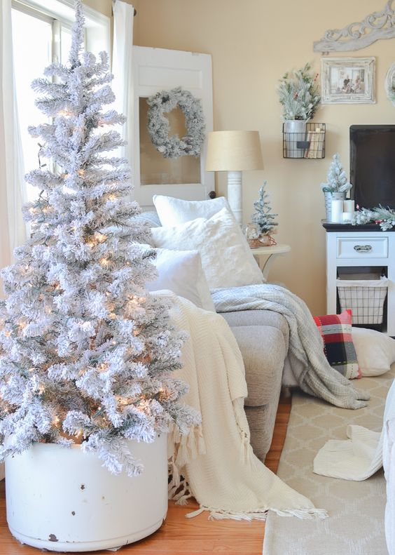 a snowy white Christmas tree like this one doesn't require any decor, just add lights and it's beautiful