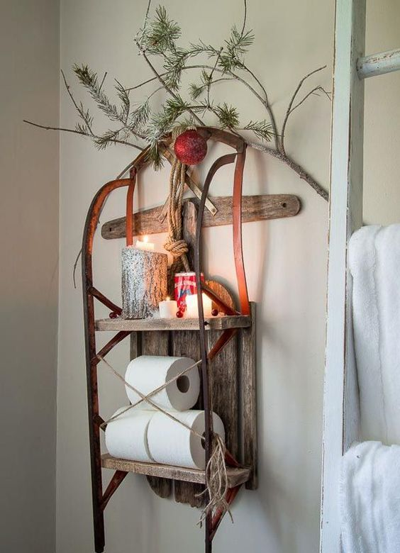 use a vintage sleigh as a shelvign unit on a wall, add candles, ornaments and evergreens