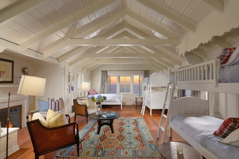 Here's a guest bedroom with gorgeous views of the sea and a fireplace for coziness