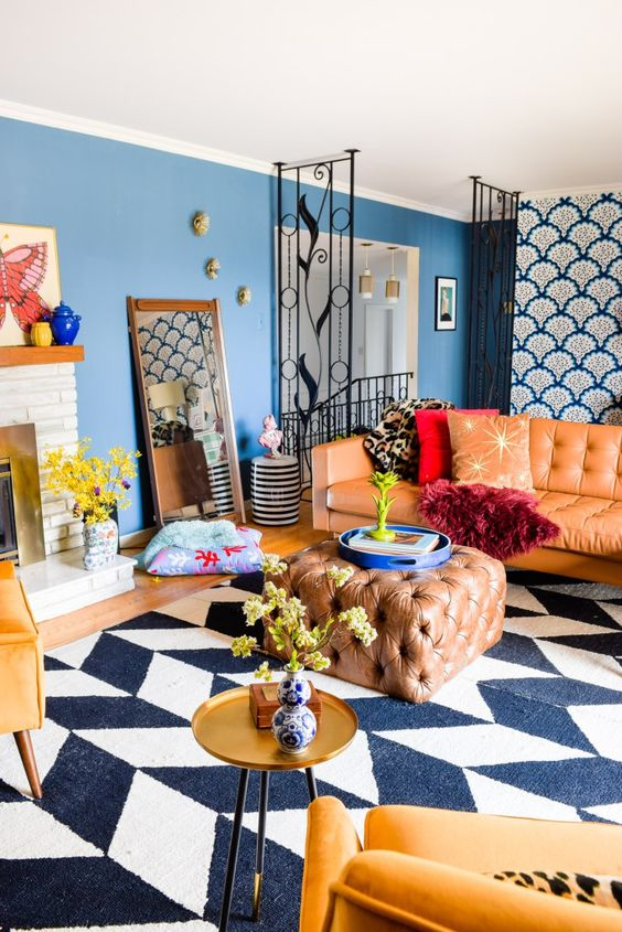 a colorful eclectic living room with modern furniture and textiles and touches of vintage