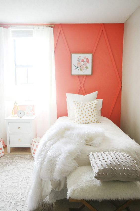 a coral architectural wall raises the guest bedroom decor to a new level and makes a colorful statement