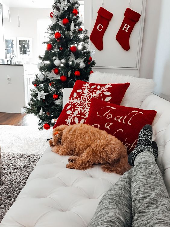 several red pillows and stockings plus ornaments are enough to make your space more holiday-like