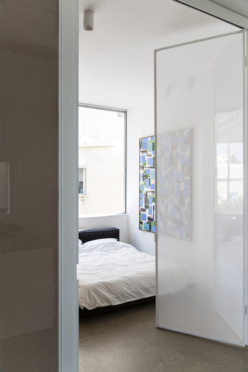 The bedroom is done with an oversized window that takes the whole wall and a large bed