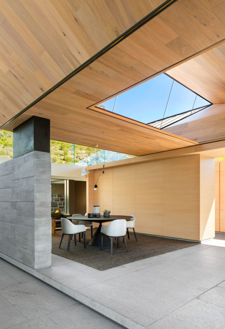 The spaces feel open yet intimate and cozy, there are skylights and windows