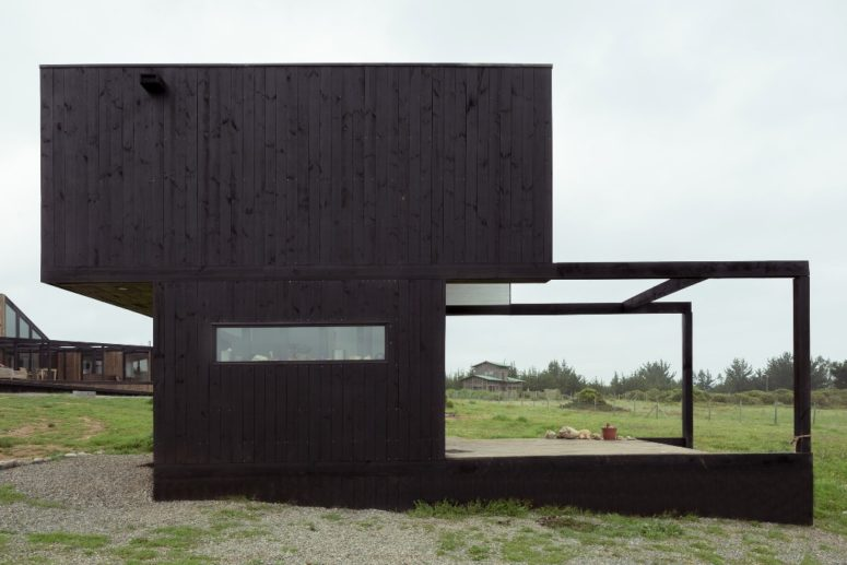 This is the second building, a black cabin with an extended deck