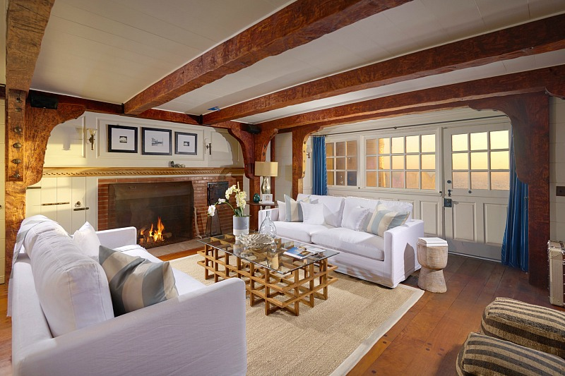 living room with gorgeous beams on a ceiling