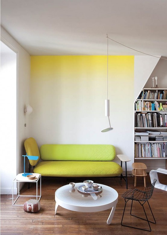 a bright ombre statement wall from yellow to neutrals and a matching neon yellow couch for a cool breakfast nook
