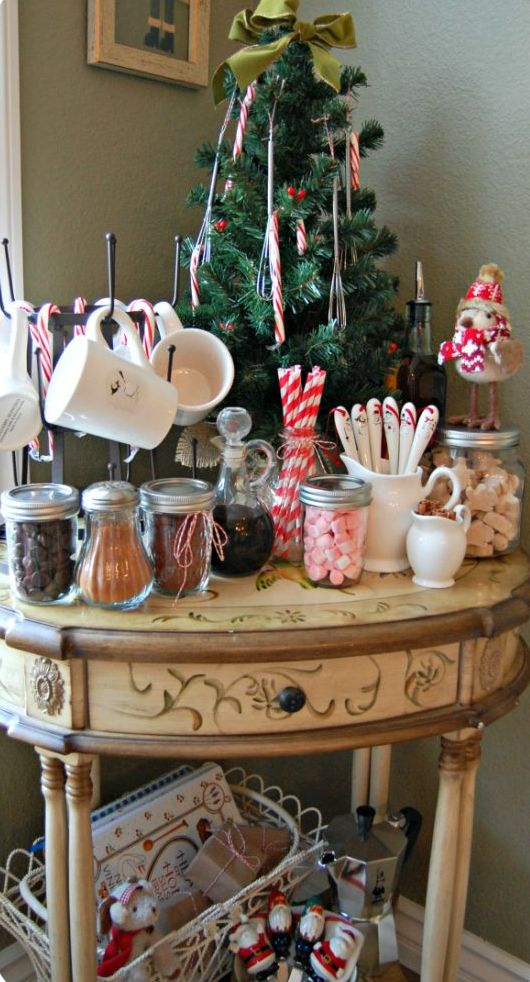 a vintage table as a hot chocolate station with sweets and a little Christmas treee in the corner