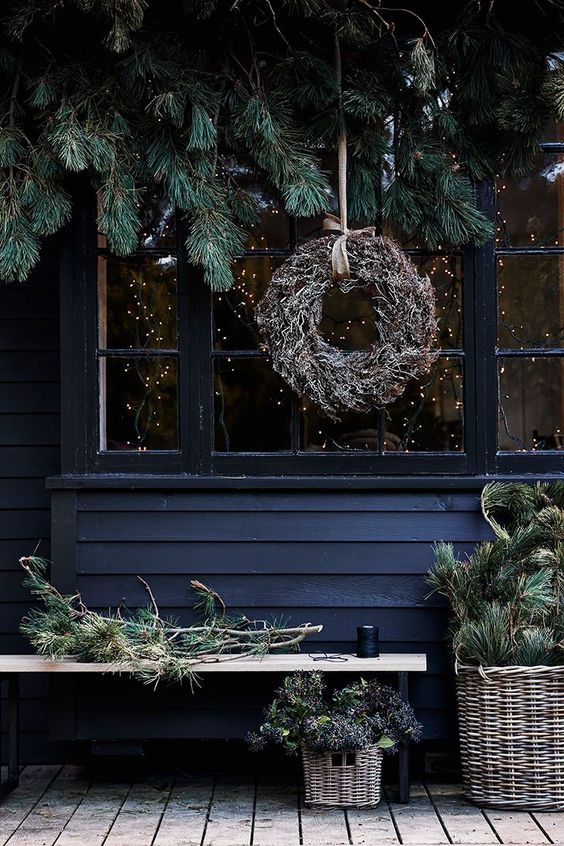 coordinate your indoor and outdoor decor, rock evergreens and a dried herb wreath to make your outdoor space hygge, too