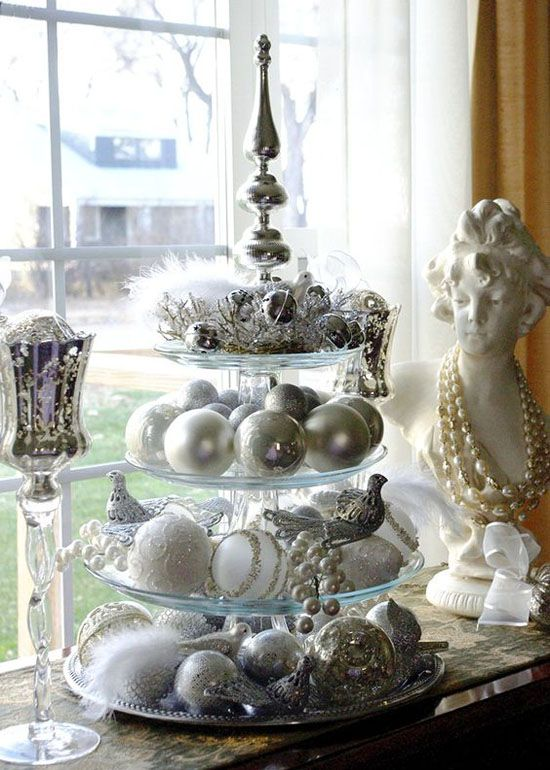 silver and white Christmas decor is a cool color scheme, which is neutral enough and has enough impact