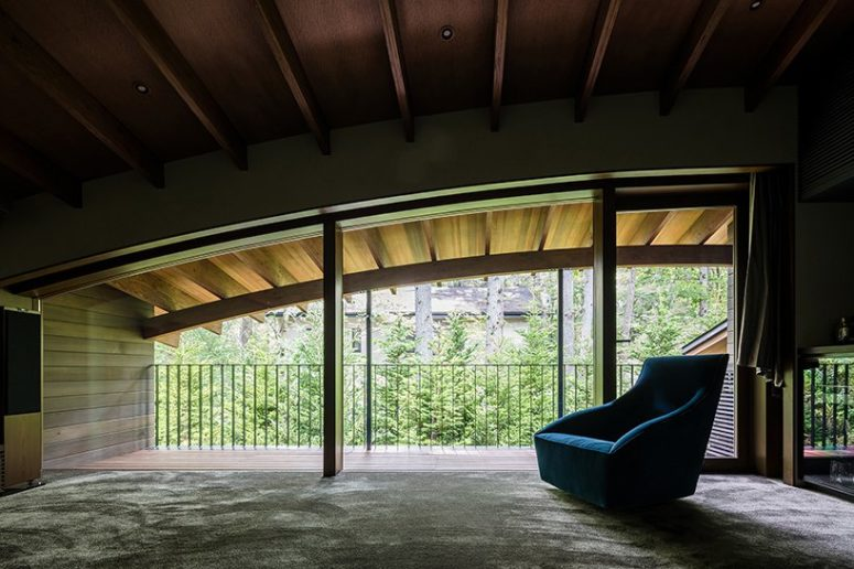 The upper floor features a comfy reading nook with views and a cozy chair