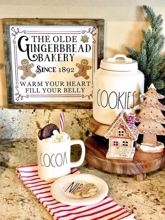 a little gingerbread station with a gingerbread tree and house plus a vintage sign