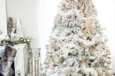 08 a neutral snowy Christmas tree with metallic glitter ornaments and lights is great as it has enough impact
