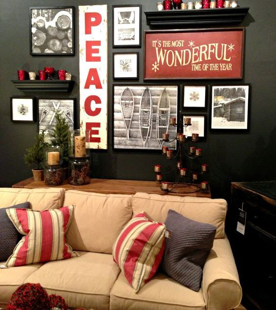 a stylish holiday gallery wall with photos, signs and candles on the shelves is a bold idea