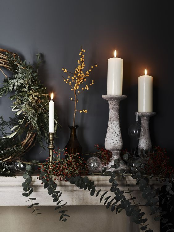 decorate your mantel with fresh greenery, berries, vines and branches and add candles for a magical feel