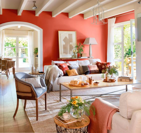a coral statement wall brightens up and refeshes a neutral living room, a couple of matching textiles echo with it
